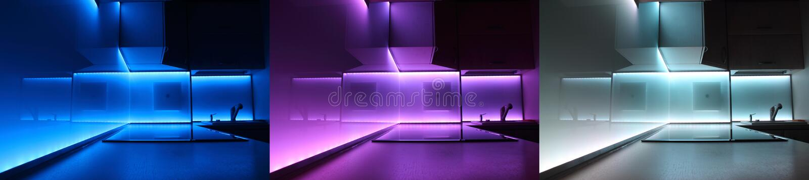 Modern luxury kitchen with led lighting. A night-time view of a modern luxury kitchen in an exclusive new home. Kitchen with LED lighting stock photo