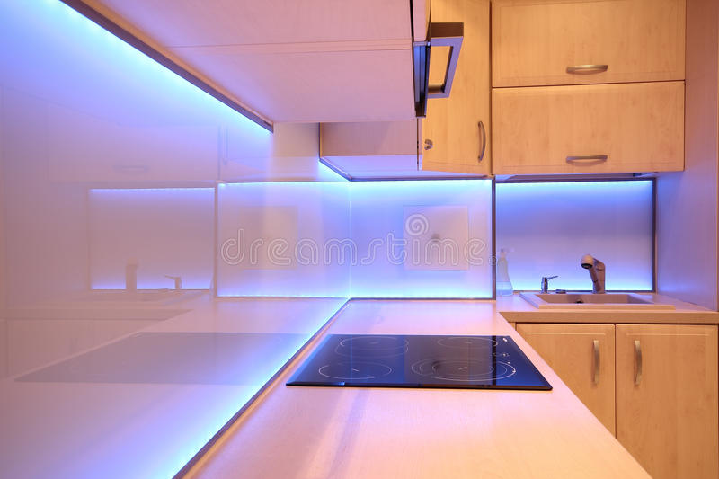 Modern luxury kitchen with purple LED lighting.  stock images