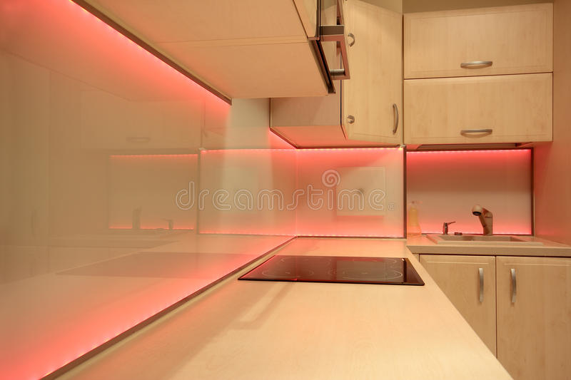 Modern luxury kitchen with red LED lighting stock photography