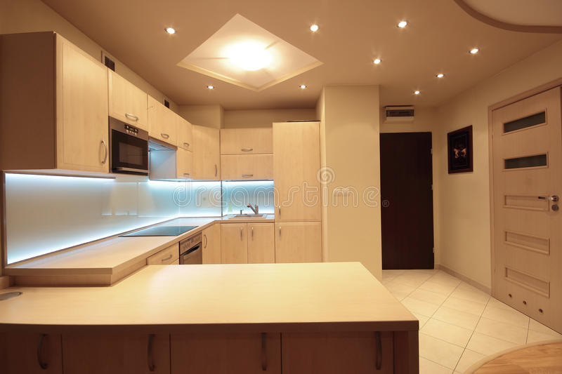 Modern luxury kitchen with white LED lighting.  royalty free stock photography
