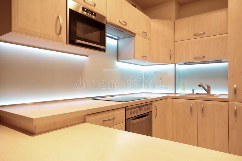 Modern luxury kitchen with white LED lighting.  royalty free stock photos