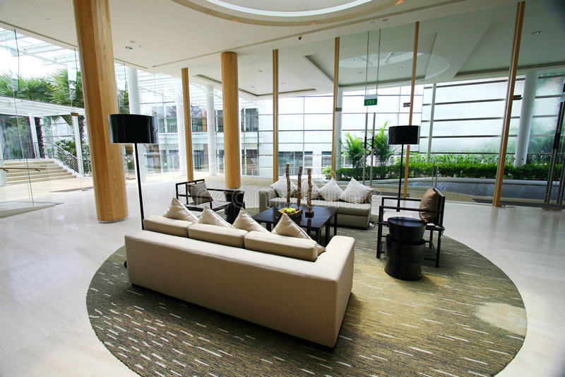 Modern luxury resort interior. The beautifully furnished interior of a new modern contemporary resort, with glass, wood and steel used in combination. Featuring stock image