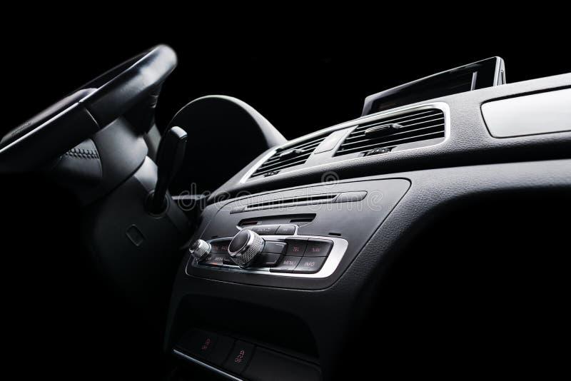 Modern Luxury sport car inside. Interior of prestige car. Black Leather. Car detailing. Dashboard. Media, climate and navigation c. Ontrol buttons. Sound system stock image
