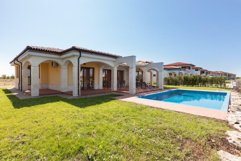 Modern luxury villa with pool stock image