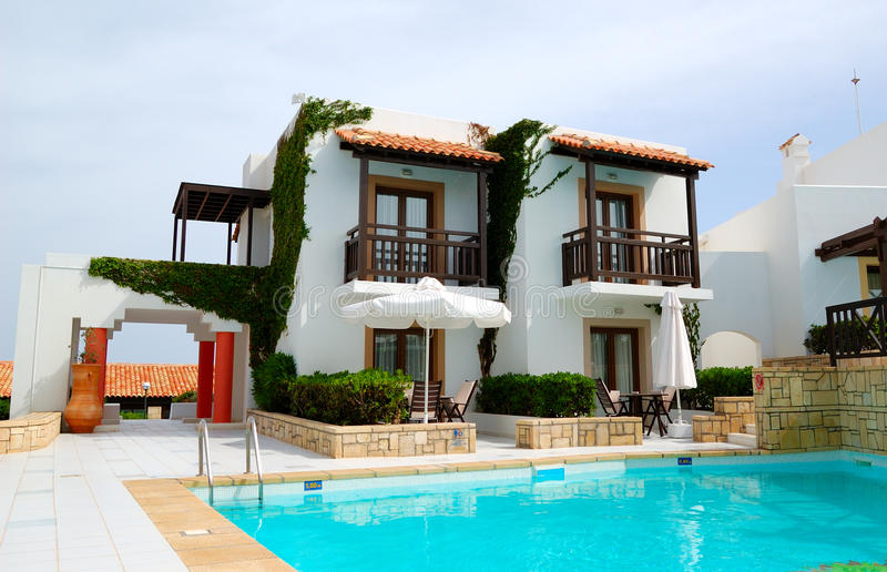 Modern luxury villa with swimming pool royalty free stock images