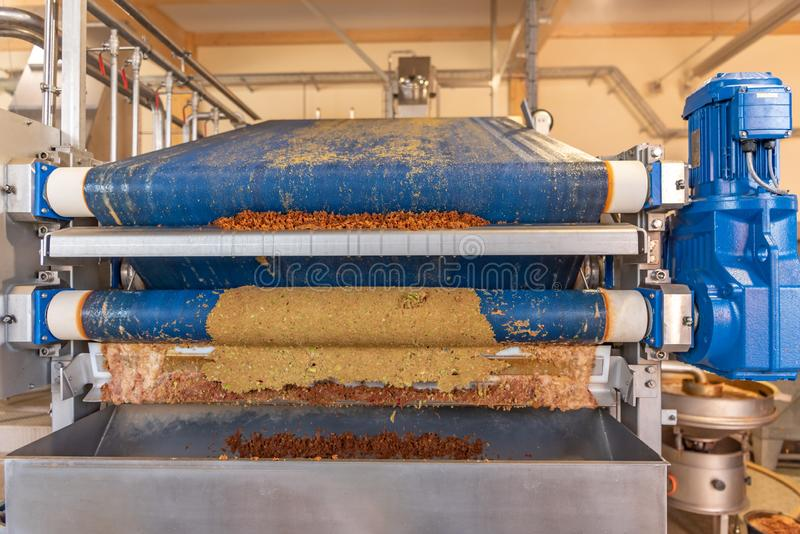 Modern Machine squeezes apples and apple pomace remain as press residues. Machine squeezes apples and apple pomace remain as press residues stock photography