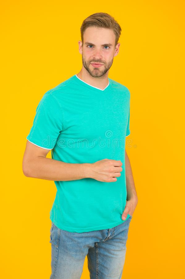 Modern male hairstyle. Hairstyle for hipster. Handsome man yellow background. Well groomed guy with bristle and stylish royalty free stock photography