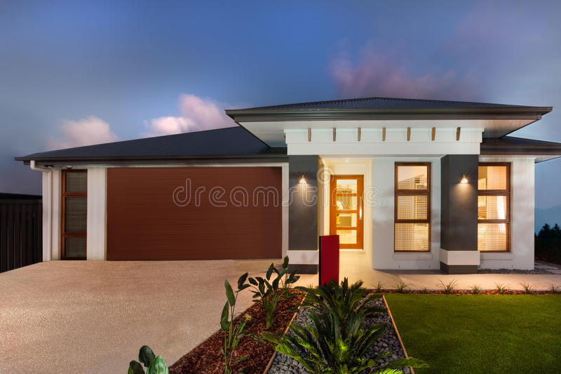 Download Modern Mansion With A Garage Showing The Front Side Stock Photo