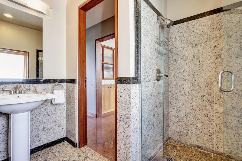 Modern marble bathroom with walk-in shower. stock photo