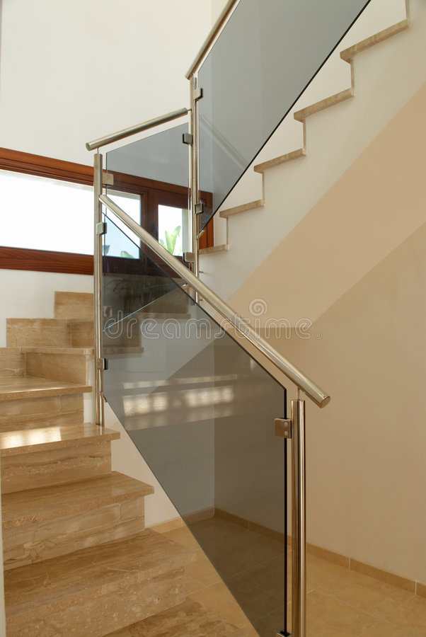Modern marble staircase. A modern marble staircase in the interior of a spanish villa stock photography