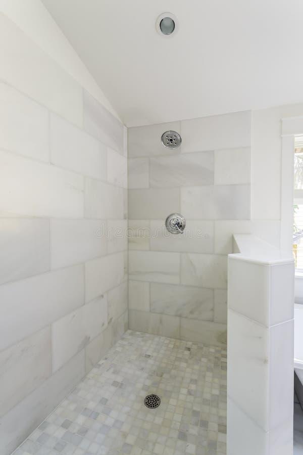 Modern marble tile walk-in shower royalty free stock image