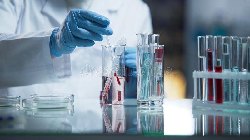 Modern medical laboratory conducting research of blood, experts at work. Stock video stock photo