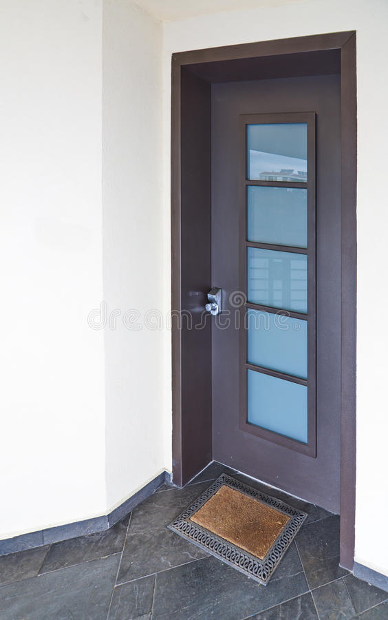 Entrance Door To A Modern Mediterranean House With Metal And Stone Elements