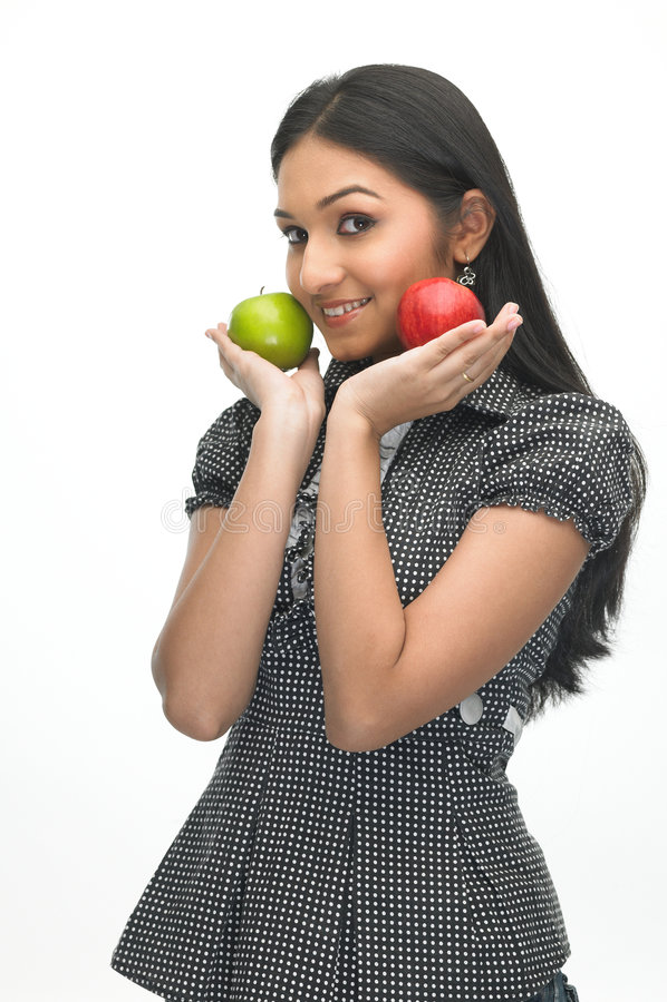 Modern meisje met groene en rode appel stock afbeeldingen