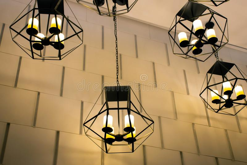 Modern metallic stylish hang ceiling lamps with beautiful wall background royalty free stock images
