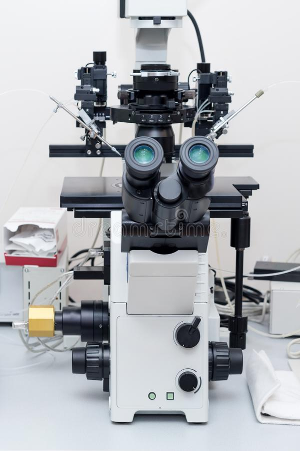 Modern microscope in biotech lab. Equipment in laboratory of Fertilization. Modern microscope in biotech lab. Equipment in laboratory of Fertilization royalty free stock photos