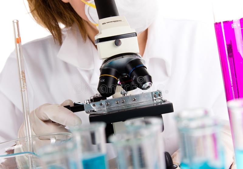 Modern microscope with female researcher stock photos