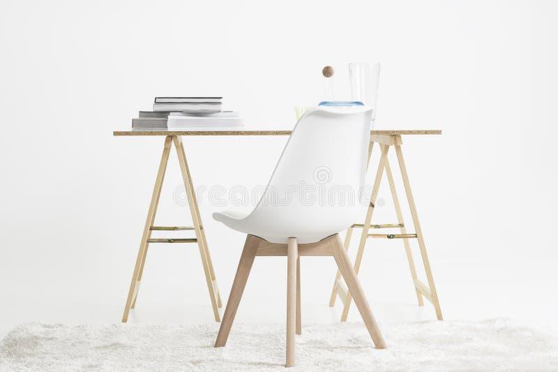 Modern minimalist skrivbord och stol royaltyfria bilder
