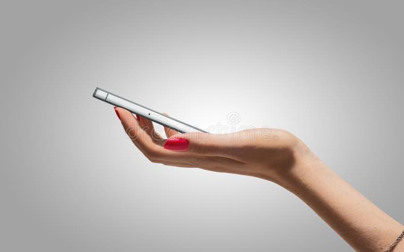 Modern mobil på handen royaltyfri foto