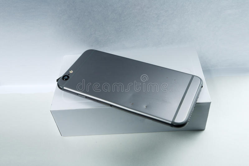 Modern mobile phone with broken back panel side on white background stock image