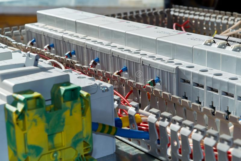 Modern modular contactors and circuit breakers with electrical wires connected to them. royalty free stock images