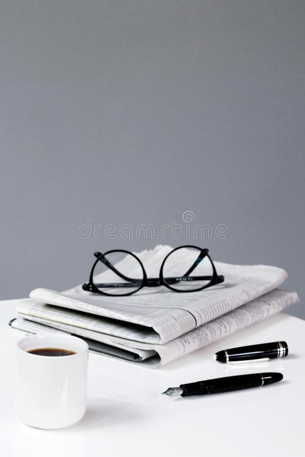 coffee newspaper break business background with pen and glasses financial royalty free stock images