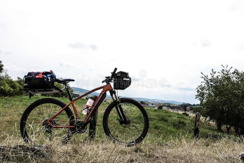 Modern mountain bike - sport, bike travel bag on long trip. New mountain bike in nature. Bike industry photo. Modern bike with bike luggage. Bike baggag. Bycicle royalty free stock photography