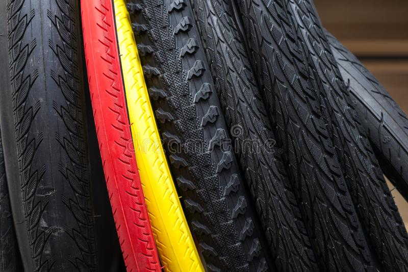 Large selection of tires with a different tread and colour. Modern mountain bike tire. Element of bicycle. Large selection of tires with a different tread and royalty free stock photos