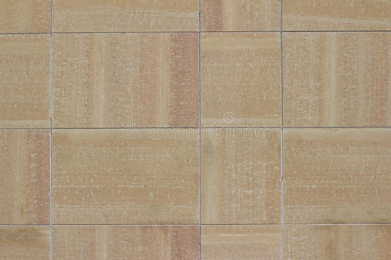Modern multi-hued stone tile wall texture in shades of beige, tan, and pink stock images