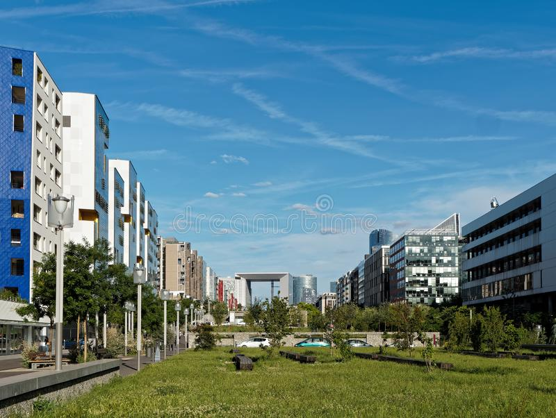 Modern Nanterre pedestrian street with La Defense in the background, Paris, France. Modern housing in Nanterre with La Defense in the background, Paris, France royalty free stock image