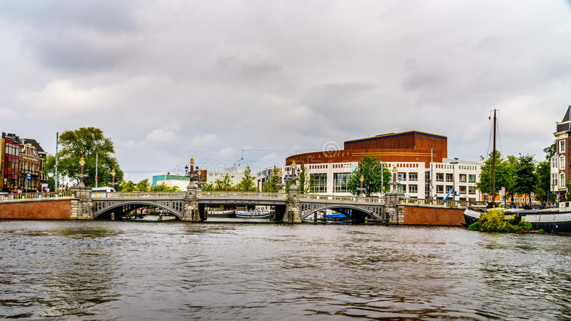 Modern National Opera and Ballet Center along the canals of Amsterdam royalty free stock photo