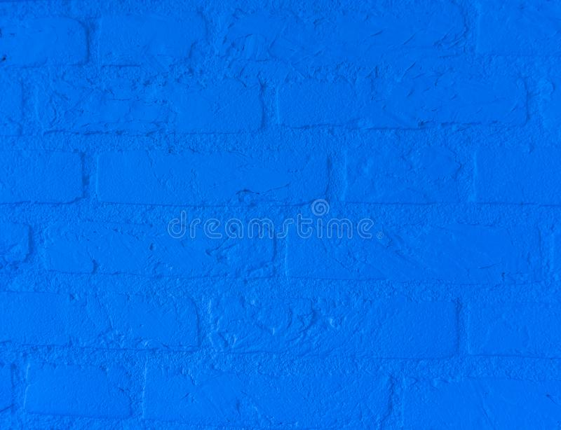 Modern neon blue stone brick wall with big bricks close up background pattern stock image