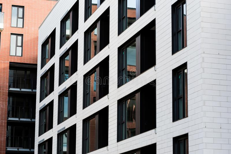 Modern and new apartment building. Multistoried, modern, new and stylish living block of flats. Real estate. New house. Newly royalty free stock photos
