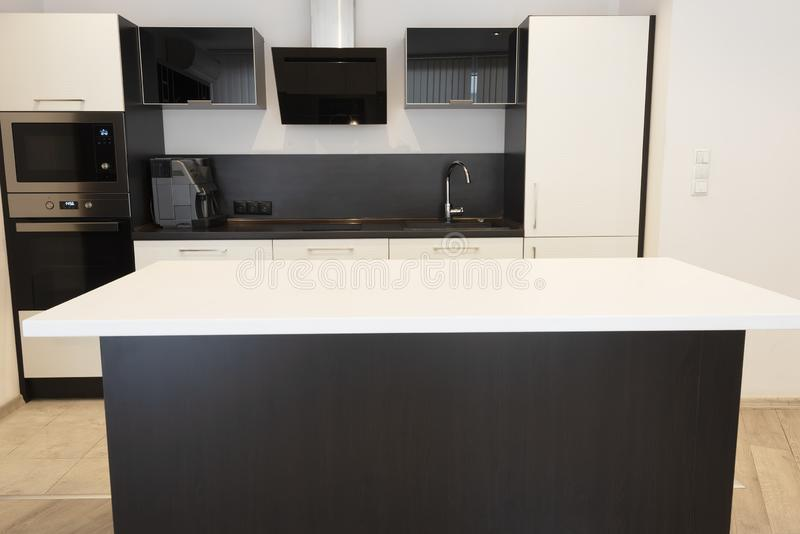Modern new light interior of kitchen with white and black furniture stock images