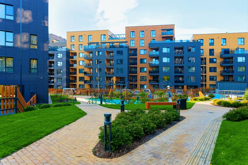 Modern new residential apartment house building complex outdoor facilities bench. Modern new residential apartment house building complex with outdoor facilities stock photo