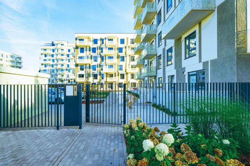 Modern new residential apartment house building with entrance gate stock images