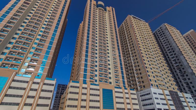 Modern new towers in Ajman timelapse hyperlapse. Cityscape of Ajman. royalty free stock images