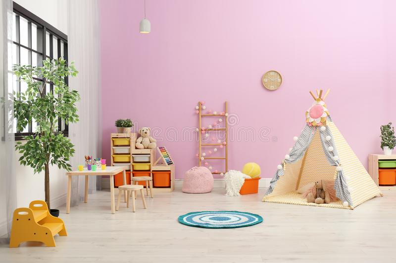 Modern nursery room interior with play tent stock photography