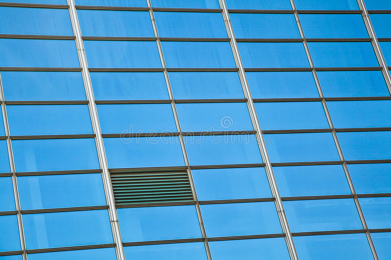 Modern office architectur at blue glass wall backgrounds. The Modern office architectur at blue glass wall backgrounds royalty free stock photography