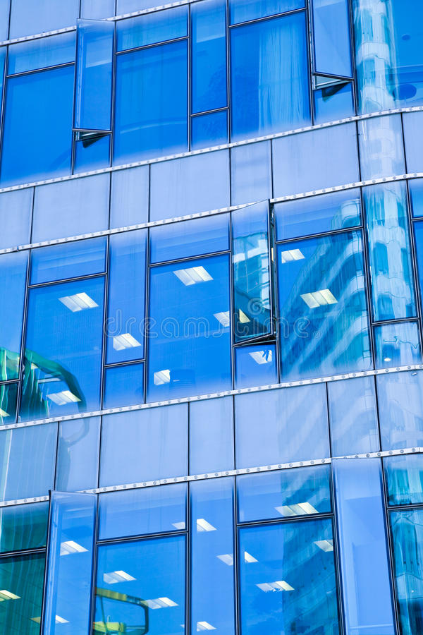 Modern office architectur at blue glass wall backgrounds. The Modern office architectur at blue glass wall backgrounds royalty free stock photos