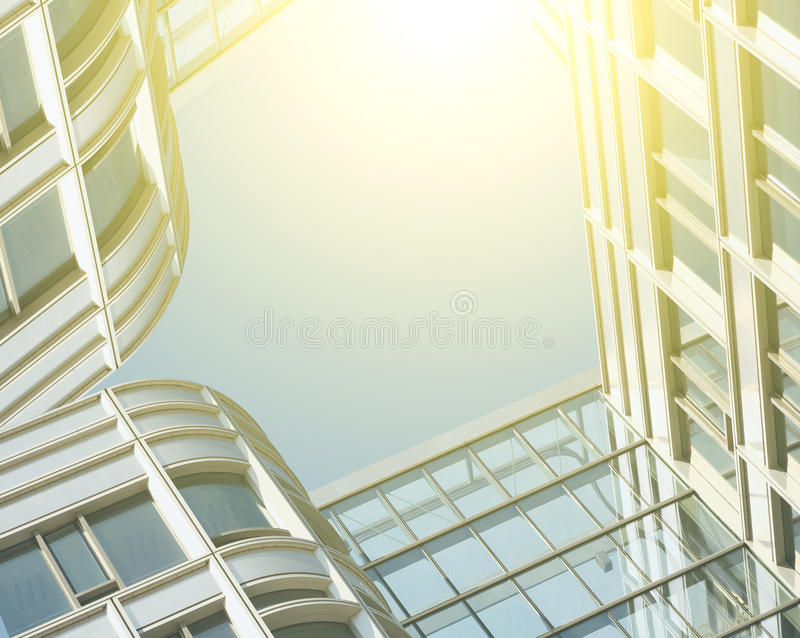 Modern office architectur at blue glass wall backgrounds. The Modern office architectur at blue glass wall backgrounds stock photos