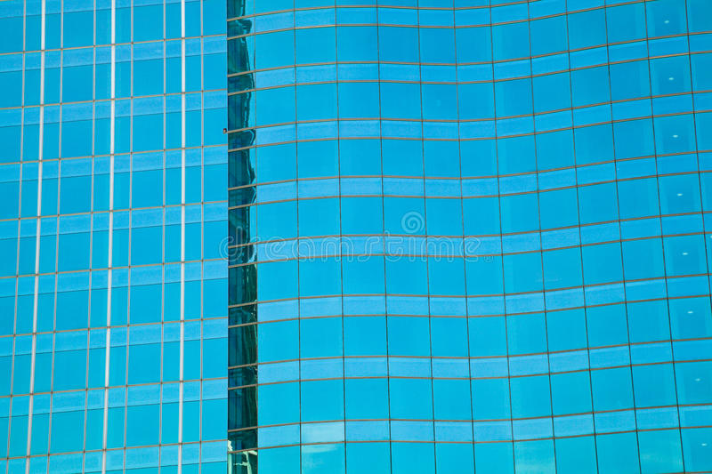 Modern office architectur at blue glass wall backgrounds. The Modern office architectur at blue glass wall backgrounds royalty free stock photo