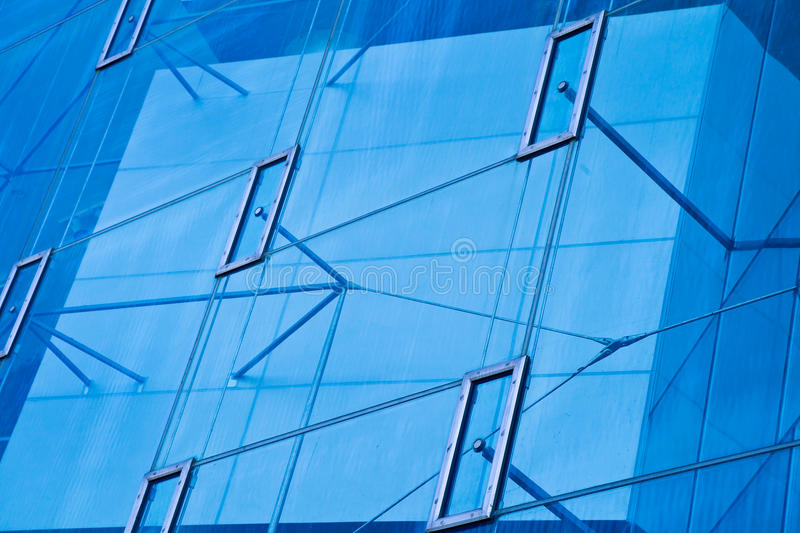 Modern office architectur at blue glass wall backgrounds. The Modern office architectur at blue glass wall backgrounds royalty free stock images