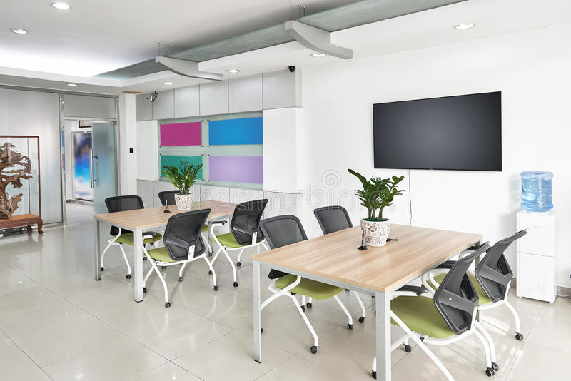 Modern office boardroom interior. Interior of modern office boardroom, working place, office space with equipment white walls and television royalty free stock images