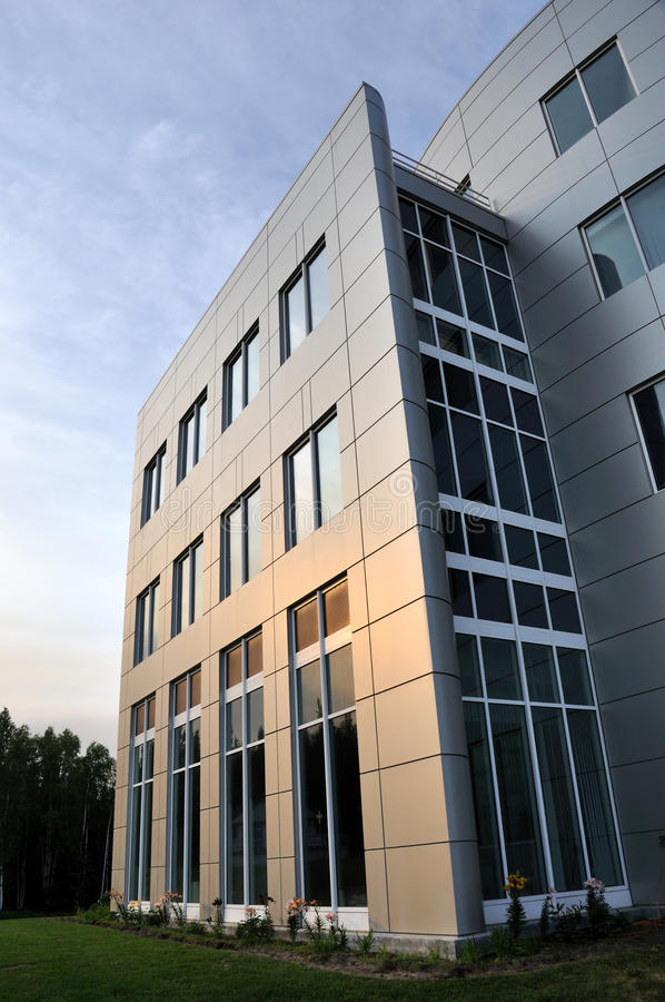 Modern Office Building. With the glow of the setting sun royalty free stock photo
