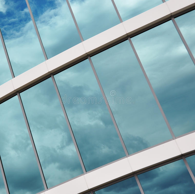 Modern office building. Glass wall of a modern office building stock image