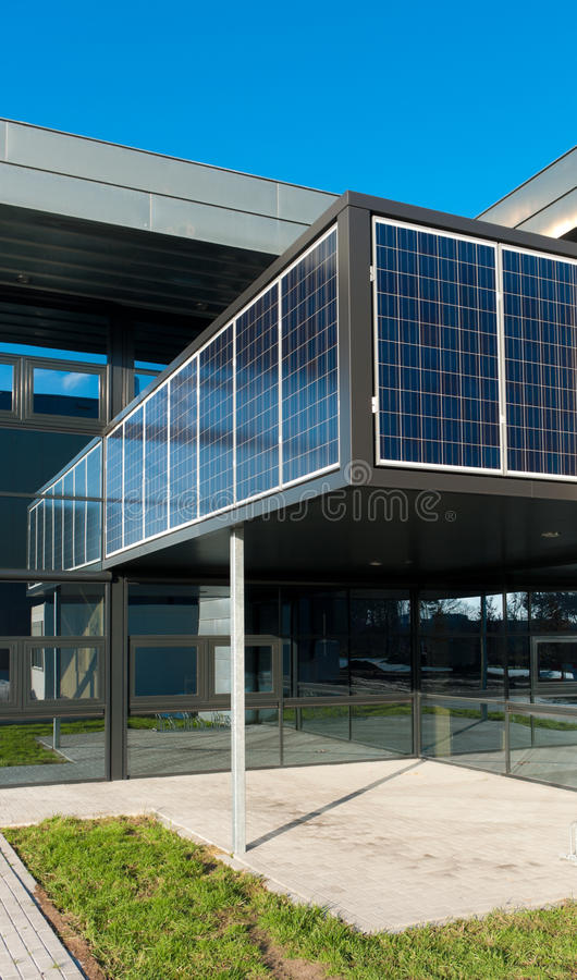 Modern office building. Entrance of a modern office building with solar panels for energy supply stock images