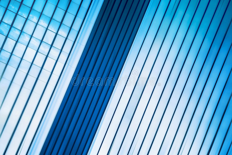Modern Office Building Abstract as Blur Business Background. Blue Glass Facade with Geometric Lines royalty free stock images