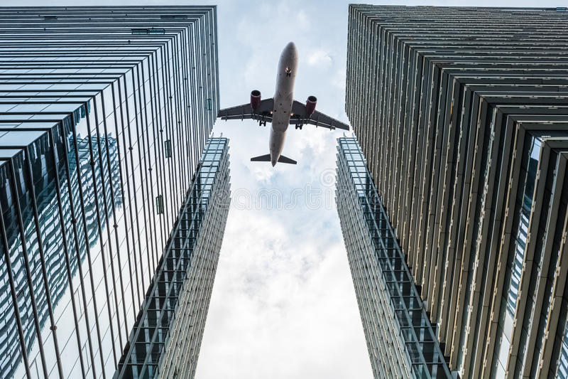 Modern office building with airplane royalty free stock photography