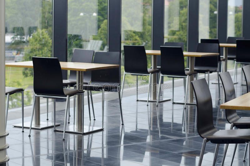Modern office building cafeteria seating area stock photo